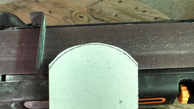 I used a coffee can to make an arc, then rough cut it on the band saw.